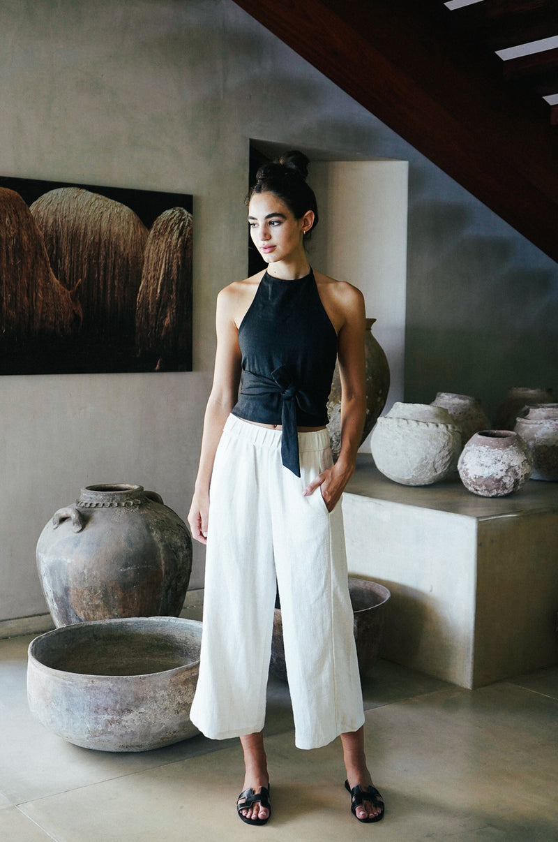 Model wearing the lady & the sailor Wrap Halter Top in black linen.