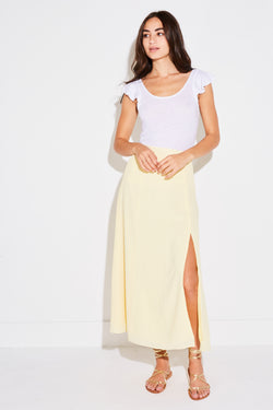 Model wearing the lady & the sailor Panel Skirt in pale yellow french woven.