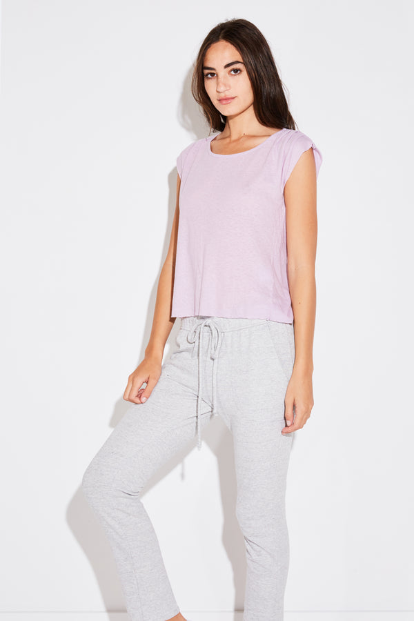 Model wearing the lady & the sailor Pleat Shoulder Tee in lilac linen cotton.
