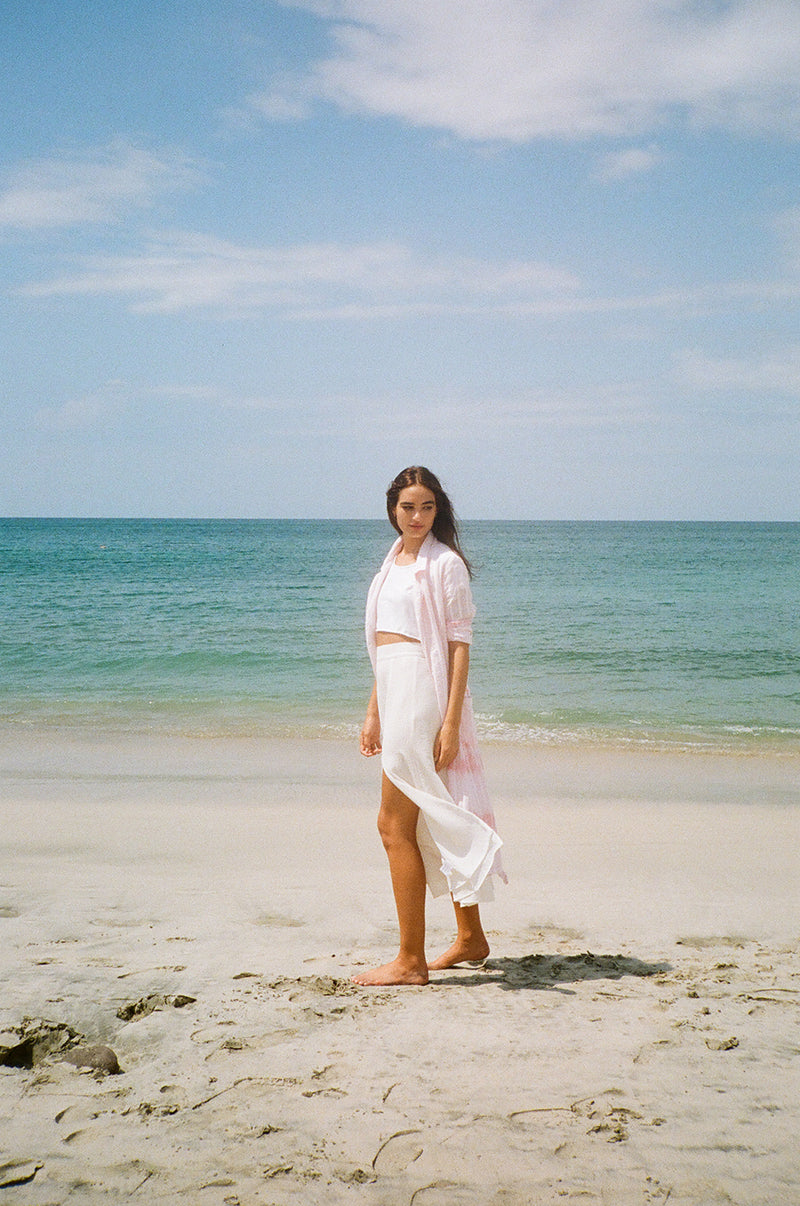 Model wearing the lady & the sailor Panel Skirt in white french woven.
