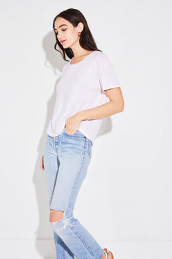 Model wearing the lady & the sailor Relaxed Split Neck Tee in shell cotton knit.