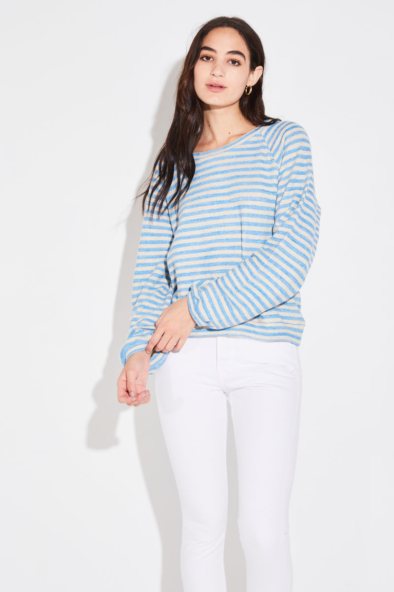 Model wearing the lady & the sailor Scoopneck Billow Sweatshirt in turquoise stripe.