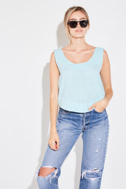 Model wearing the lady & the sailor Scoop Swing Tank in powder blue gauze.