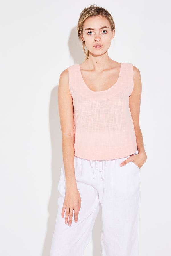 Model wearing the lady & the sailor Scoop Swing Tank in pale pink gauze.