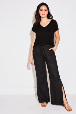 Model wearing the lady & the sailor Side Slit Pant in black linen.