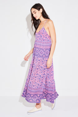Brunette model wearing Spell & The Gypsy Collective Journey Strappy Maxi Dress in mulberry.