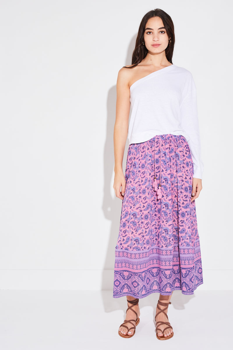 Brunette model wearing Spell & The Gypsy Collective Journey Midi Skirt in mulberry.