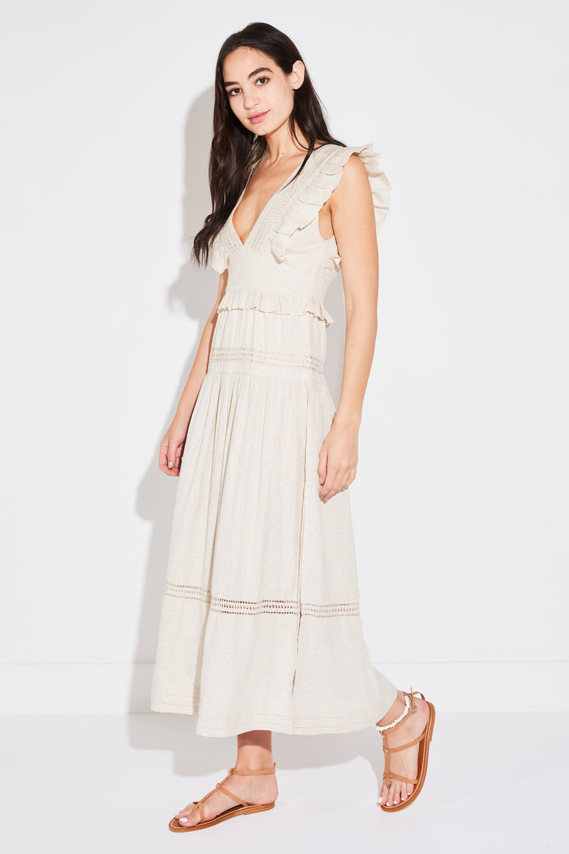 Brunette model wearing Spell & The Gypsy Collective Lola Frill Maxi Dress in biscuit.