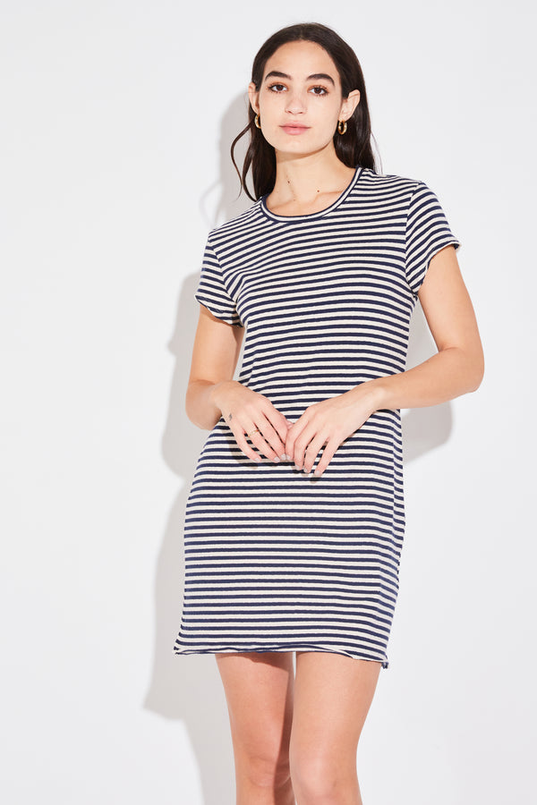 Model wearing the lady & the sailor Split Seam Mini Dress in navy vintage stripe cotton.