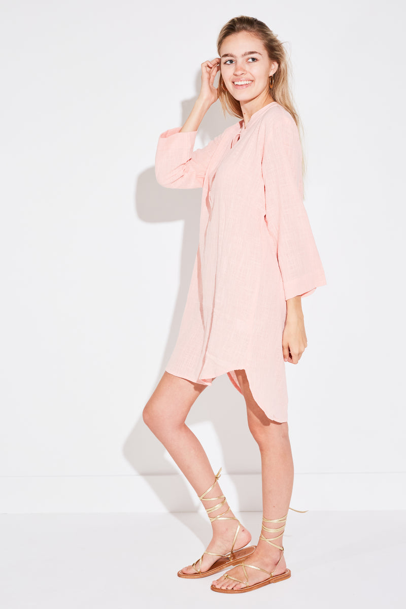Model wearing the lady & the sailor Tunic Mini Dress in pale pink gauze.