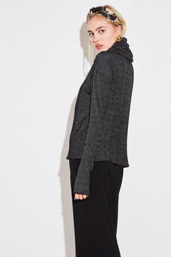 Model wearing the lady & the sailor Oversized Turtleneck in anthracite knit.