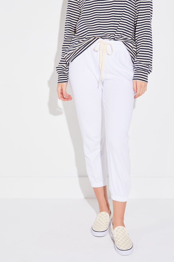 Model wearing the lady & the sailor Vintage Sweatpant in heather white mineral terry cotton.