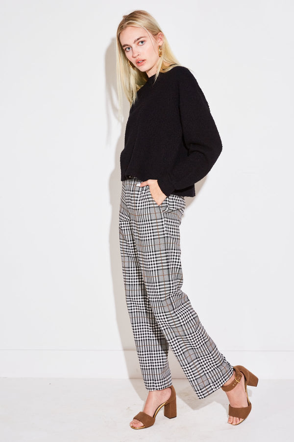 Model wearing the lady & the sailor Ankle Trouser in white plaid.