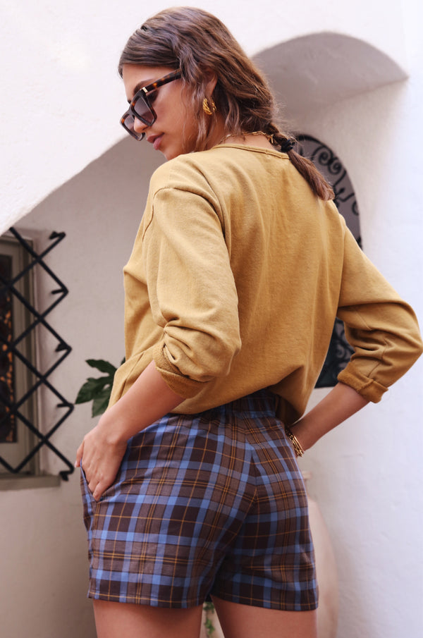 Model wearing the lady & the sailor Weekend Shorts in Mocha Plaid.