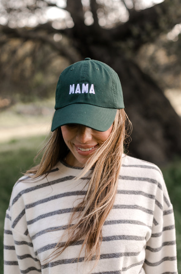 Model wearing the lady & the sailor Mama Baseball Cap in Hunter Green and White embroidery.