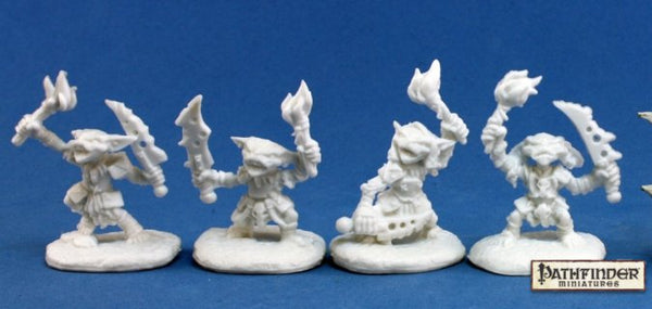 Goblin Pyros holding a torch and a jagged dagger unpainted