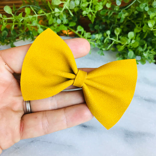 PRINTS - Mustard Suede Bow