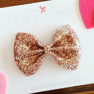 rose gold glitter bow on nylon headband or hair clip