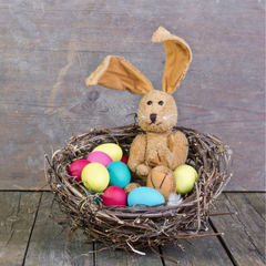 Easter bunny toy in nest of eggs