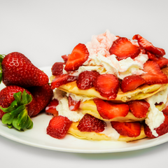 Pile of Pancakes with Strawberry and cream