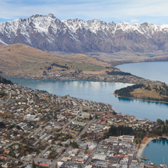 New Zealand landscape, small city with mountainous backdrop