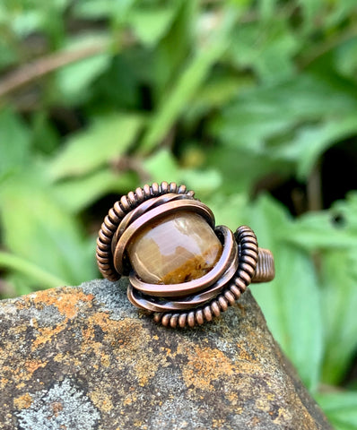 Beautiful Little Brown Jasper Cabochon (created by Monkeylion Designs) wrapped in square copper that is handwoven and coiled.