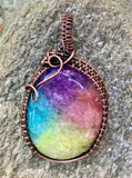 Colorful Rainbow Quartz (dyed) wrapped in handwoven copper. A great way to brighten any day!!