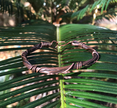 Multiple strands of copper coiled with heavy gauge copper that has been oxidized, polished and sealed. This bracelet is a quick go to fix to complete your everyday outfit.