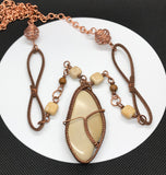 Tumbled River Rock wrapped in copper necklace, with mixed stones, leather and copper accents and chain