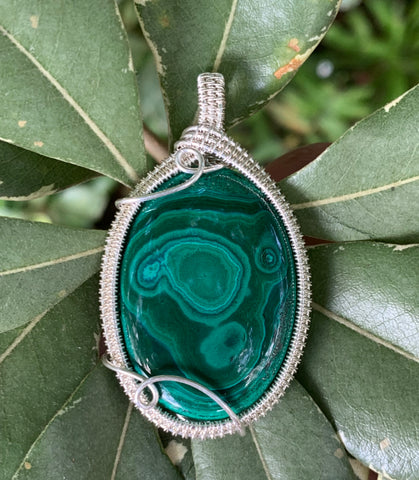 Alluring Malachite wrapped in Sterling Silver