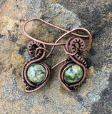 Beautiful Rainforest Jasper combined with handwoven copper weaves and coils to create a unique pair of earrings. On handmade copper  ear wires.