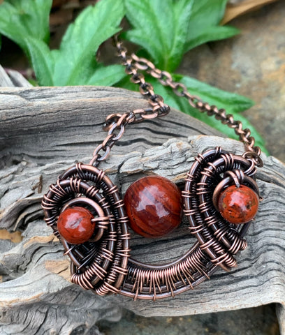 Wire wrapped Copper Necklace with Red Jasper Accents adds a pop of color to your outfit.