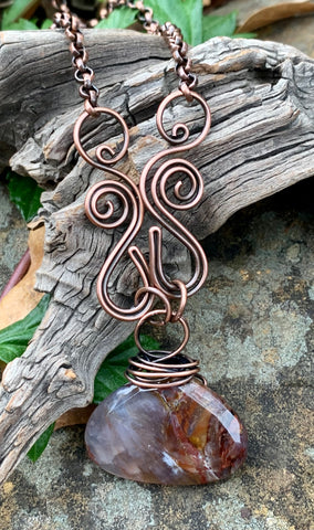 Hand formed Copper Swirls and a Beautiful Faceted Pietersite Stone in this stunning handmade necklace.