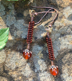 Fun and Flirty Handmade Earrings - combining, copper, brass and aluminum with brilliant Carnelian accents.