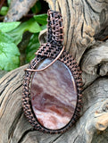 Colorful Purple Coprolite ( fossilized Dinosaur Poo ) wire wrapped Pendant in Copper.