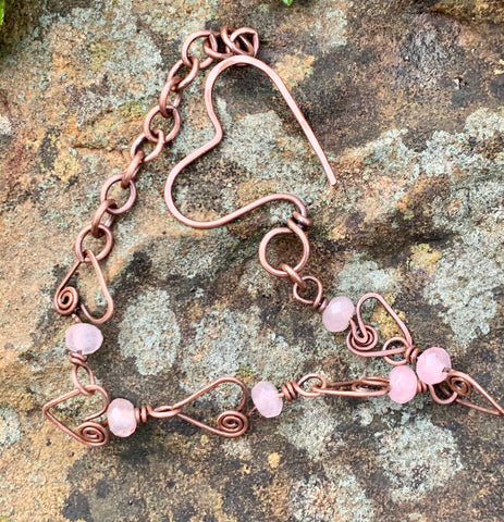 Delicate Adjustable Hammered Copper Heart Link Bracelet with Rose Quartz Rondelles and a hammered heart clasp.