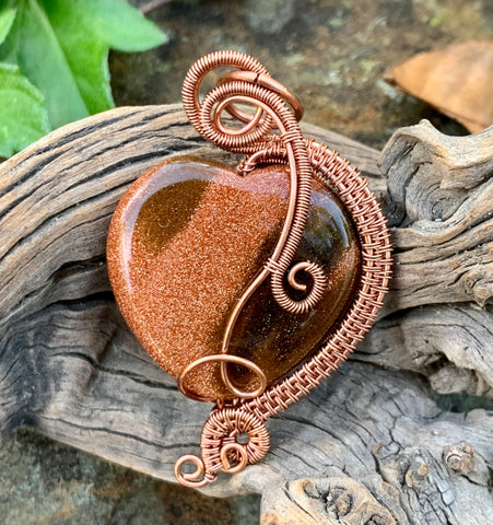 Sparkling Goldstone Heart Pendant with shiny copper weaves and swirls. This Pendant is reversible and can be worn with either side facing out.