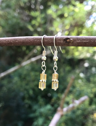 Silver tone yellow crystal earrings