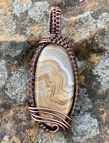 Swirling Lace Agate Pendant in wire wrapped copper.
