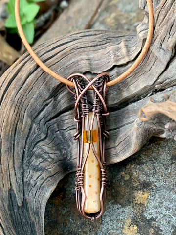 Petrified Palm Wood Necklace wrapped in Copper with Glass Bead Accent and Leather Cord.