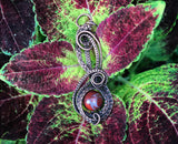 Rainbow Jasper intricately woven copper pendant designed by Monkeylion Designs