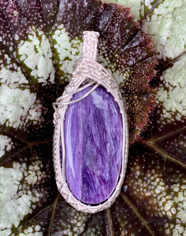 Stunning Charoite wrapped in hand woven Sterling (.925) and Fine (.999) Silver.