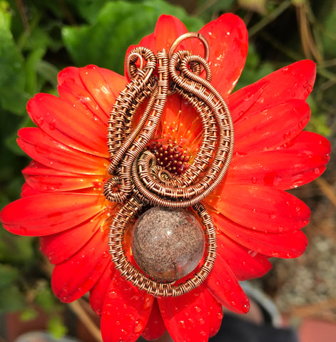 Sophisticated Woven Copper and Quartz Pendant