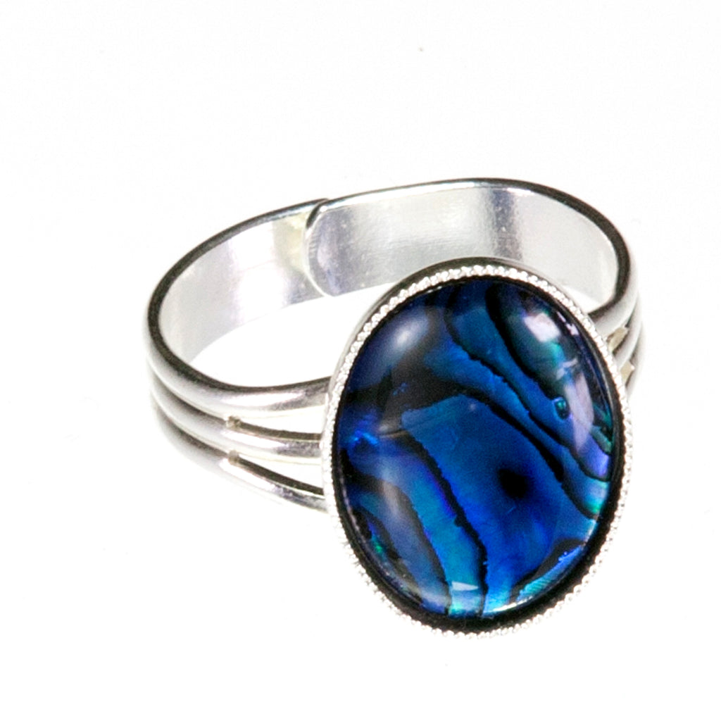 Adjustable dress ring will compliment any outfit. Suitable for medium to large fingers the 18mm x 13mm Blue Abalone Shell cabochon makes a statement without being over powering.  Abalone is believed to strengthen the immune system and increase stamina.     It is thought to enhance the four C's  Communication  Cooperation  Commitment  Compromise     leading to harmony and balance.     The Abalone shell has been tossed and turned in the ocean for many years and through this process, its true beauty