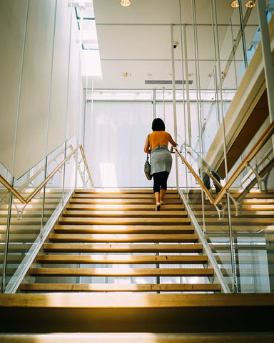 woman walking up stairs office