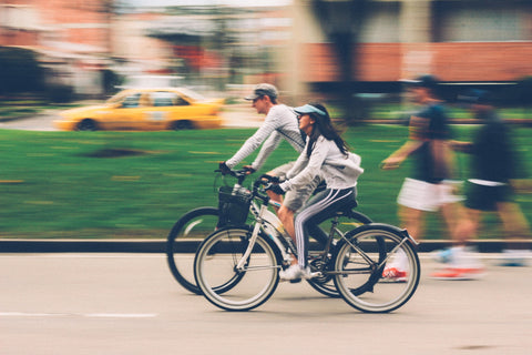 man and woman riding bike