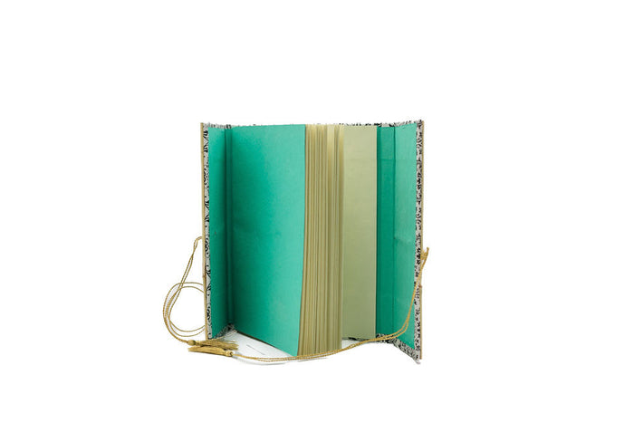 recycled-cotton paper journal with gold tassel ties