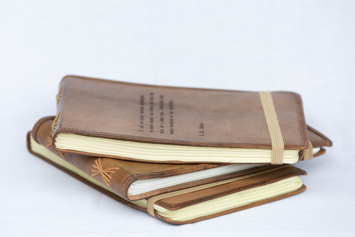 leather-bound notepads with quotes and hand-stitched spines