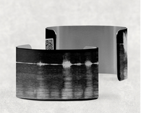 Load image into Gallery viewer, sound shadows sound art wide cuff bracelet with unique sound in X-Ray black with white