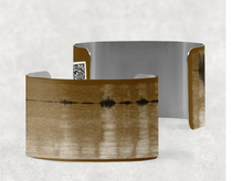 Load image into Gallery viewer, sound shadows sound art wide cuff bracelet with unique sound in brown and ivory